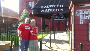 Dave and Jodi in front of the not so haunted house at the fair
